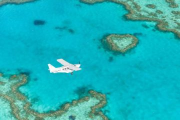 whitsundays islands scenic flight heart reef airlie beach whitehaven beach backpacker combo